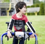 Older Boy with arms supporting walk stroller